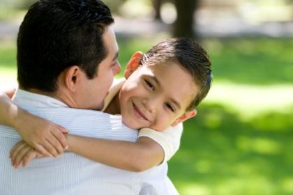 hisp-dad-son-hug-smiles